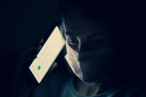 Woman on phone while wearing mask