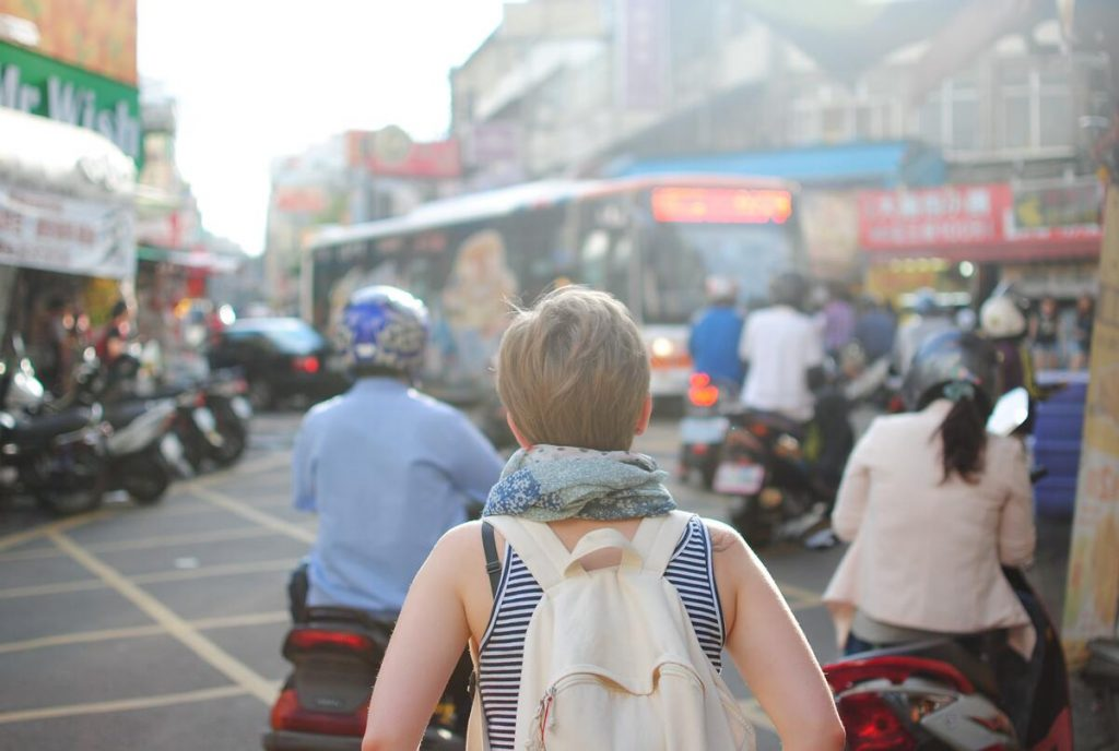Woman traveling alone in a busy street